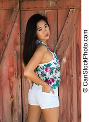 Laotian - Pretty young Laotian woman in a flower print...