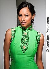 Pretty young Latina in a green sheath dress