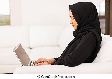 young middle eastern woman using laptop