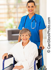 young nurse pushing senior woman