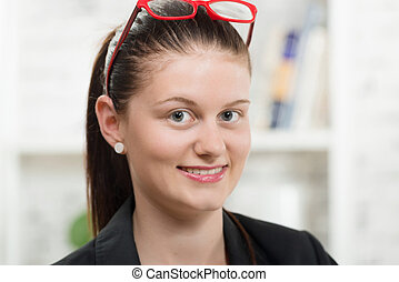 pretty young secretary with red glasses