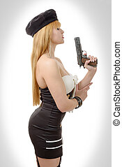 pretty young sexy woman with gun on white