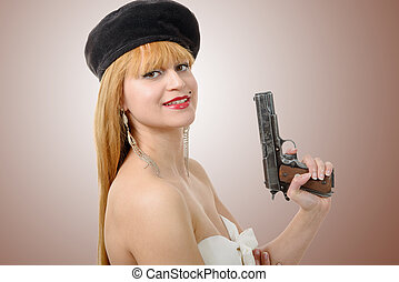 pretty young sexy woman with gun