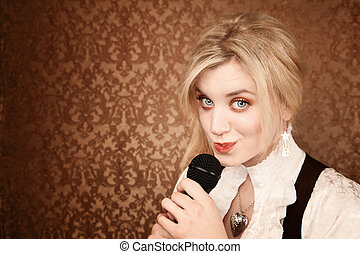 Pretty young singer or comedian with microphone - Pretty...