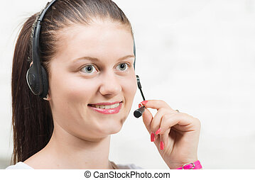 Pretty young smiling woman with a headset