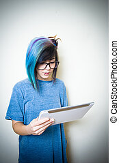 Pretty young teen woman using tablet