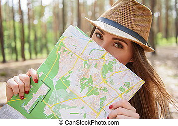 Pretty young traveler navigating location