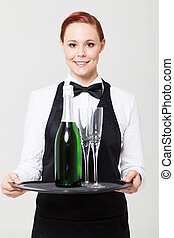 pretty young waitress holding tray