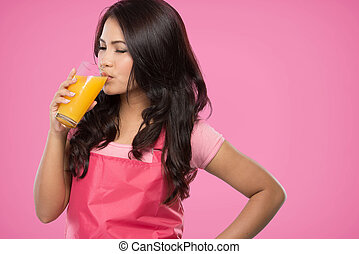 pretty young wife drinking orange juice