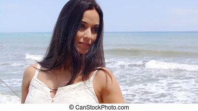 Pretty Young Woman at the Beach Smiling at Camera