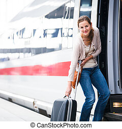 Pretty young woman boarding a train