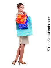 Pretty young woman carrying shopping bags