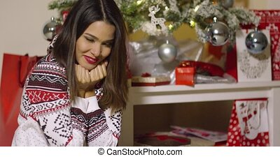 Pretty young woman celebrating Christmas alone