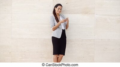 Pretty young woman checking her mobile phone