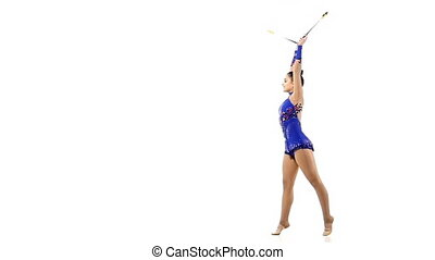Pretty young woman doing exercises with Juggling clubs, slow motion