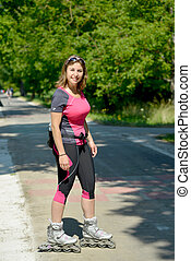 pretty young woman doing rollerskate on a track