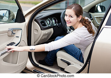Pretty young woman driving her brand new car - Pretty young...