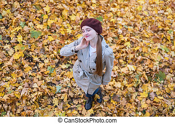 pretty young woman enjoying good weather in autumn forest. Top view