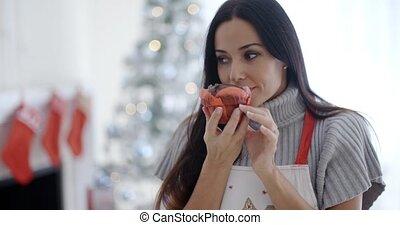 Pretty young woman enjoying her Christmas baking