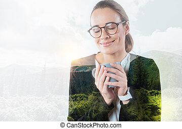Pretty young woman enjoying her drink