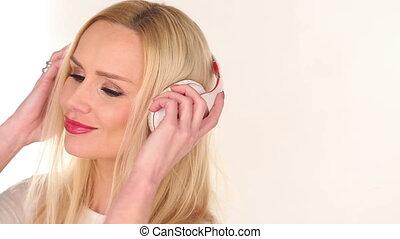 Pretty young woman enjoying her music