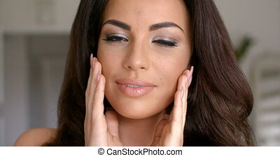 Pretty Young Woman Face with Hands on Sides