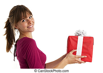 pretty young woman holding a present isolated on white
