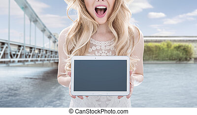 Pretty young woman holding a tablet