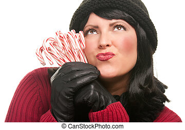 Pretty Young Woman Holding Candy Canes