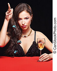 pretty young woman holding dices on red table