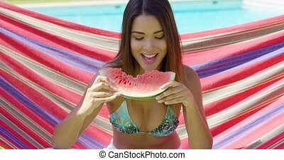 Pretty young woman holding eaten watermelon