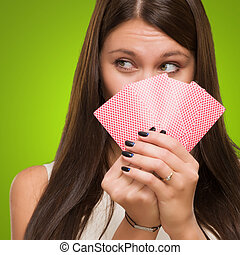 Pretty Young Woman Holding Playing Cards