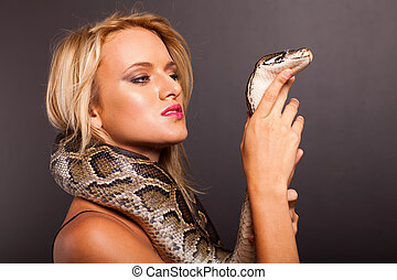 young woman holding python