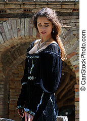 Pretty young woman in a medieval dress