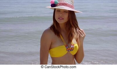 Pretty young woman in a trendy sunhat