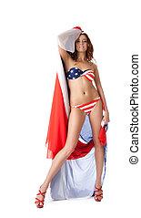 Pretty young woman in bikini with fabric