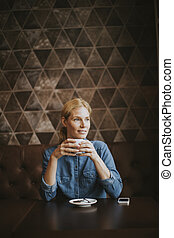 Pretty young woman in cafe