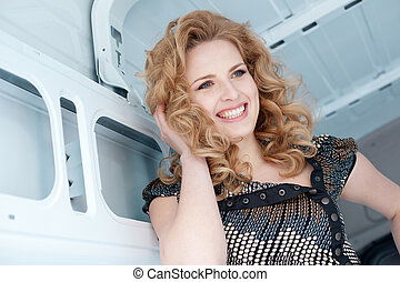 Pretty young woman in cargo van ins