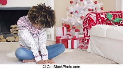 Pretty young woman in Christmas living room