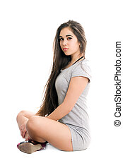 Pretty young woman in gray dress