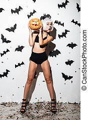 Pretty young woman in halloween costume cat