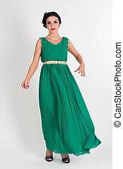 Pretty young woman in long green dress