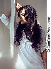 pretty young woman in old -fashioned style room looking at window, lifestyle people