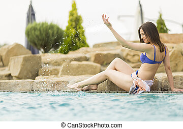 Pretty young woman in the pool