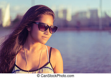 Pretty young woman in thoughtful po