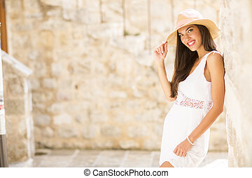 Pretty young woman in white dress
