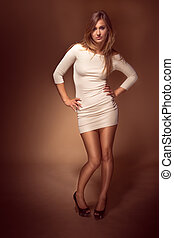 Pretty Young Woman in White Sexy Dress