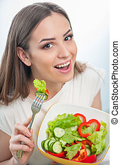 Pretty young woman is testing healthy food