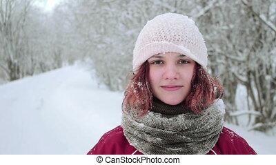 Pretty young woman looking at a camera