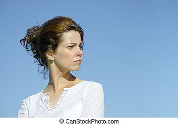 Pretty young woman looking back over her shoulder